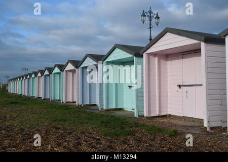 PASTEL-COLOURED BEACH HUTS IN EARLY MORNING LIGHT, EASTNEY, PORTSMOUTH UK. - Stock Photo