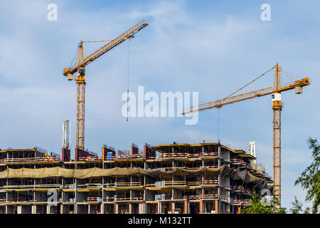 Crains on construction site of building. Construction background - Stock Photo