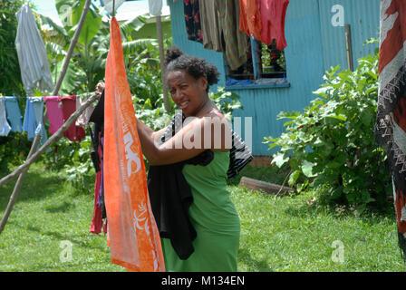 Young Woman hanging up washing, Rakiraki, Fiji. - Stock Photo