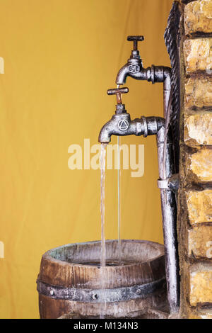 An Outside Tap In A Garden Running With Fresh Water Turned