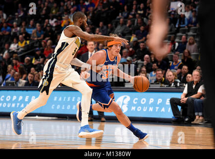 Denver, USA. 25th Jan, 2018. New York Knicks guard Ron Baker (R) drives toward the basket against Denver Nuggets - Stock Photo