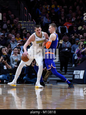 Denver, USA. 25th Jan, 2018. Denver Nuggets center Nikola Jokic (L) fights New York Knicks forward Kristaps Porzingis - Stock Photo