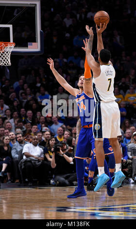 Denver, USA. 25th Jan, 2018. Denver Nuggets forward Trey Lyles (R) shoots over the top of New York Knicks center - Stock Photo