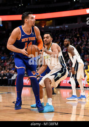 Denver, USA. 25th Jan, 2018. New York Knicks center Willy Hernangomez (L), fights off Denver Nuggets forward Trey - Stock Photo