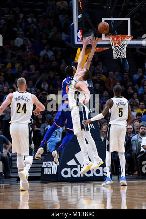 Denver, USA. 25th Jan, 2018. New York Knicks center Enes Kanter (C-L) attempts to shoot over Denver Nuggets center - Stock Photo