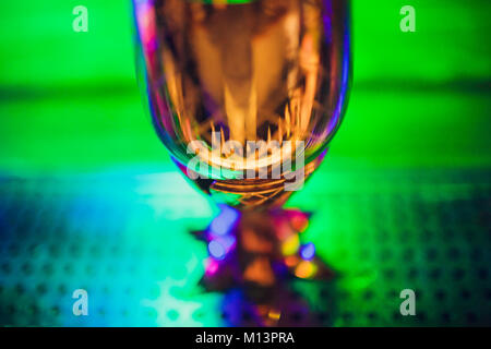 Clinking glasses on bright lights background - Stock Photo