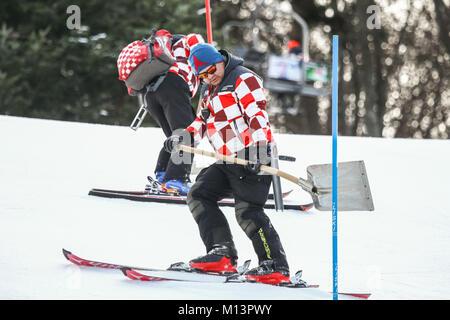 ZAGREB, CROATIA - JANUARY 3, 2018 : The man is preparing ski run for the Audi FIS Alpine Ski World Cup Women's Slalom, - Stock Photo