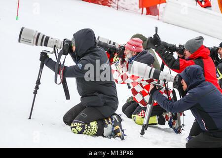 ZAGREB, CROATIA - JANUARY 3, 2018 : Photographers on the ski run of the Audi FIS Alpine Ski World Cup Women's Slalom, - Stock Photo
