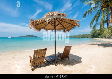 Beach Chairs and Umbrella on summer island in Phuket, Thailand. Summer, Travel, Vacation and Holiday concept. - Stock Photo