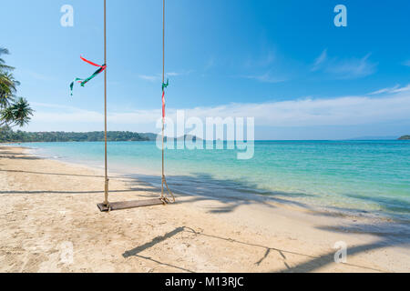 Swing hang from coconut palm tree over summer beach sea in Phuket ,Thailand. Summer, Travel, Vacation and Holiday - Stock Photo