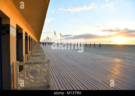 France, Calvados, Pays d'Auge, Deauville, the beach, Promenade des Planches (stage walk), lined with beach cabins - Stock Photo