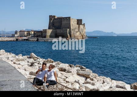 Italy, Campania, Naples, historic centre listed as World Heritage by UNESCO, young couple making a selfie before - Stock Photo