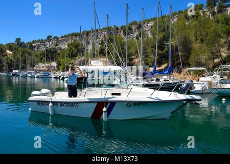 France, Bouches du Rhone, Cassis, National Park of the Calanques, Calanque de Port Miou (cove), boat patrol of the - Stock Photo