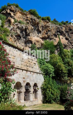 France, Var, Provence Verte, Cotignac, olive press at the foot of the tufa cliff of 80 meters high and 400 meters - Stock Photo