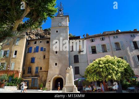France, Var, Provence Verte, Cotignac, Place de la Mairie and the Clock tower - Stock Photo