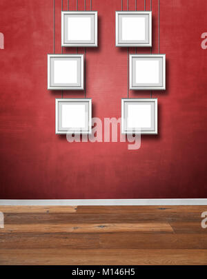 Red textured wall and Alu frames hanging - Stock Photo