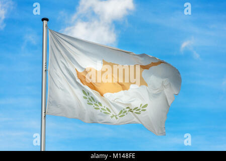 Closeup of single cypriot flag waving in the wind in front of blue sky - Stock Photo