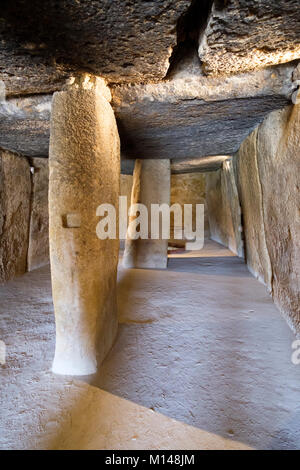 Interior of the largest neolithic dolmen in Europe, Dolmen de Menga, Antequera, Malaga, Andalusia, Spain. - Stock Photo