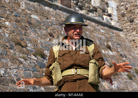 Actor, dressed as a WWII Soldier, giving a talk about  the Dunkirk Evacuations, at Dover Castle, 2017 - Stock Photo