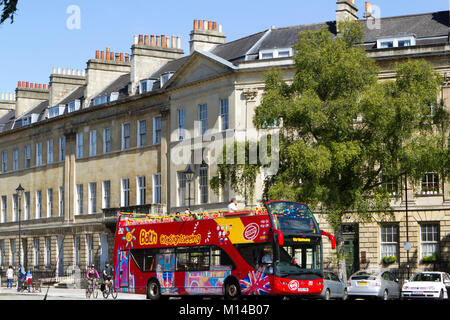 Bath, UK - 19th June 2011: Visitors on an open top tour bus in summer sunshine in the City of Bath, Somerset, UK. - Stock Photo
