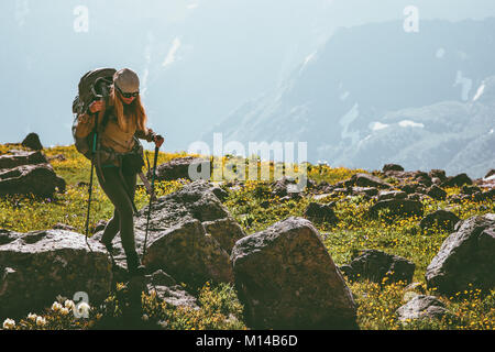 Active vacations in mountains woman hiking with backpack adventure Travel Lifestyle concept outdoor mountaineering - Stock Photo