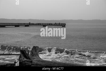 A view of the pier at Dash Point, Washington on a rainy day. - Stock Photo
