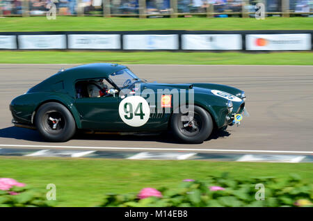 1962 AC Cobra owned by Jason Wright racing in the RAC TT Celebration at the Goodwood Revival - Stock Photo