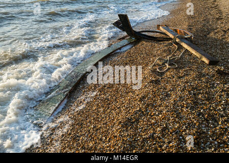 Storm debris washed up on the shingle beach at Meon Shore on the Solent at Titchfield, Hampshire, UK - Stock Photo