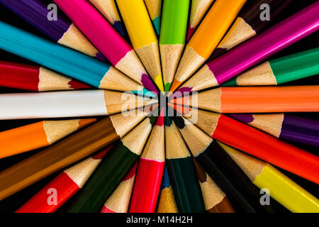 Colored Pencils in a symmetrical Pattern - Stock Photo