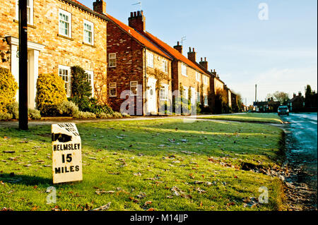 milepost at Sutton on the Forest, North Yorkshire - Stock Photo