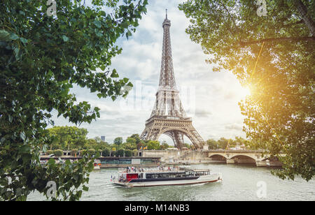 View from the Seine shore to the eiffel tower in paris. - Stock Photo