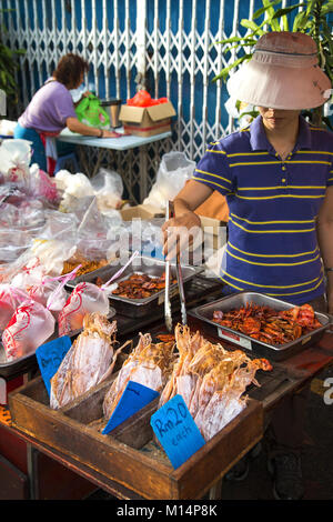 Asian street vendors at the market selling selection of the local seafood, meat and vegetables, Melacca, Melaka, - Stock Photo