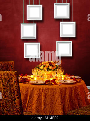 Luxurious festing table against Red textured wall and Aluminum frame hanging - Stock Photo