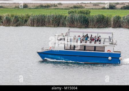 boat sailing on the river Ebro with tourists , Ebro Delta, Tarragona, Catalonia, Spain - Stock Photo