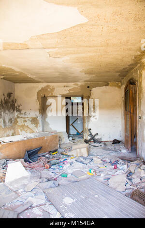 Interior of a vandalised  room in an abandoned building - Stock Photo