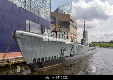 The USS Torsk (a Tench Class submarine) in front of the National Aquarium,  Baltimore Inner Harbor, Baltimore, Maryland, - Stock Photo