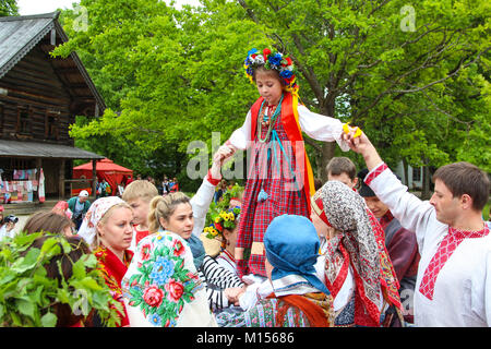Reconstruction of the ancient Slavic pagan rites 'spike' / 'walking spikelets.' Girls and women in Russian traditional - Stock Photo