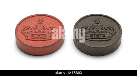 Red and Black Wood Checkers Game Pieces Isolated on White Background. - Stock Photo