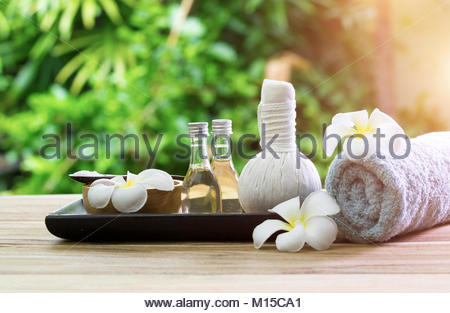 Beautiful spa composition with flowers on wooden background - Stock Photo