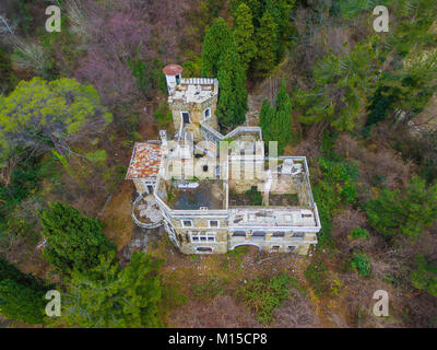 Drone view of the abandoned old mansion called Dacha Kvitko among the thicket in autumn day, Sochi, Russia - Stock Photo