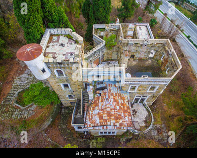 Drone view of the abandoned old mansion called Dacha Kvitko near Kurortnyy Prospekt in autumn day, Sochi, Russia - Stock Photo