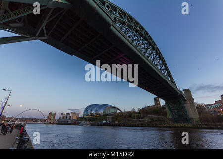 Newcastle, England - December 31, 2017: Newcastle Quayside with Tyne bridge in the foreground and the Millennium - Stock Photo