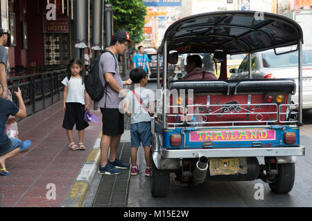 Tuk tuk vehicles on the streets of Bangkok - Stock Photo
