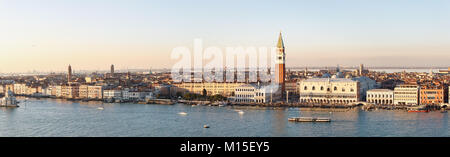 Skyline of Venice with the Grand Channel, the Doges' Palace and the bell tower of San Marco in sunset - Stock Photo