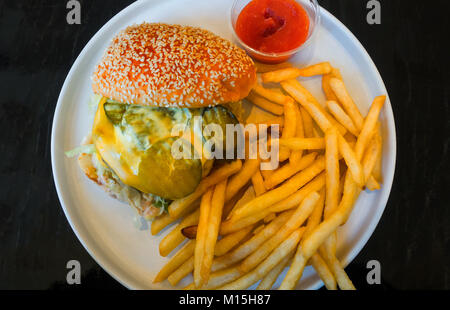 A burger and fries, the Supreme designed by Alvin Cailan for Chefs Club Counter in SoHo, New York City - Stock Photo