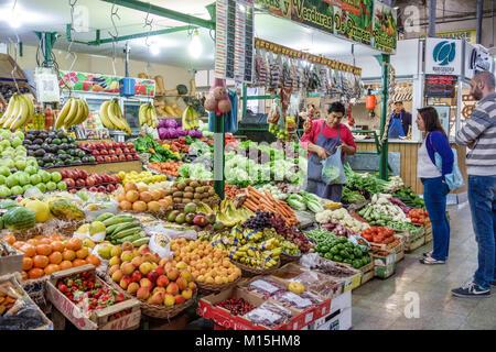 Buenos Aires Argentina Mercado San Telmo covered indoor market marketplace produce kiosk vendor fruits vegetables - Stock Photo