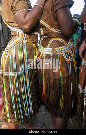 Datoga woman in traditional leather dress adorned with beads and brass bracelets - Stock Photo