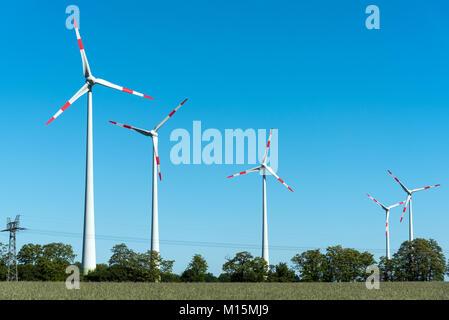 Wind energy converters seen in rural Germany - Stock Photo
