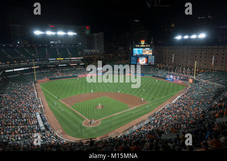 Night time view of Oriole Park at Camden Yards, home to the Baltimore Orioles Major League Baseball team in Baltimore, - Stock Photo
