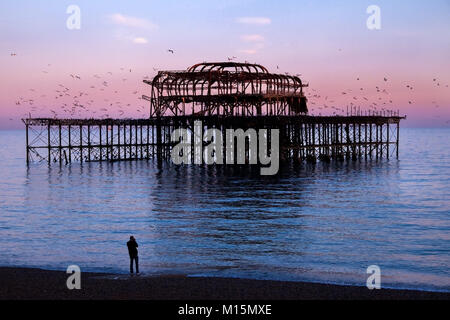Brighton, United Kindom, derelict west pier, the metal frame work of the derelict West Pier at sunset, the sea is - Stock Photo
